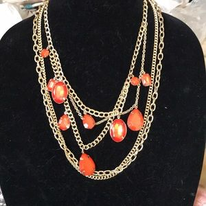 Gold chains with orange stones by Stephan & co
